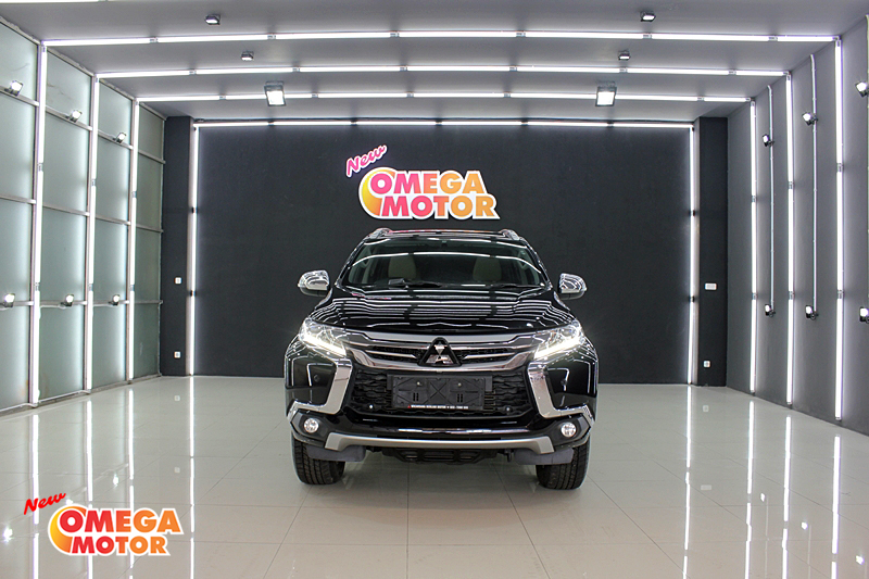 Omega Mobil MITS. PAJERO SPORT DAKAR ULTIMATE HIGH 2.5 BEIGE INTERIOR AT (KM 25.643)